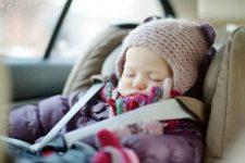 Sweet toddler girl sleeping in a car seat