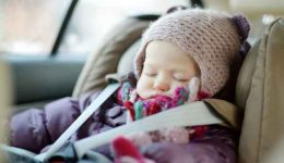 Sweet toddler girl sleeping in a car seat